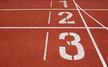 Running track numbers one two three in stadium  Stock Photo