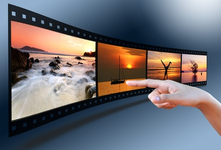 exclusive photo: hand pointing image in 3D film strip Stock Photo