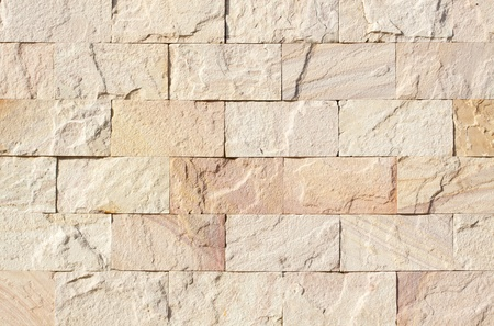 sand stone brick wall for background photo