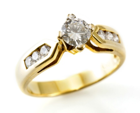 Golden ring with diamond isolated on the white  photo