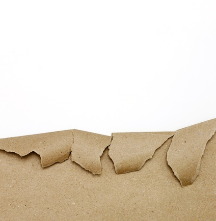 Ripped brown paper on white background  photo