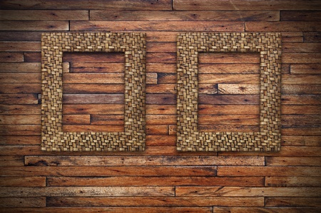 two bamboo frames on wood wall photo