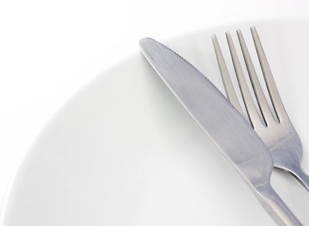 White plate, fork and knife on white background Stock Photo - 13814156