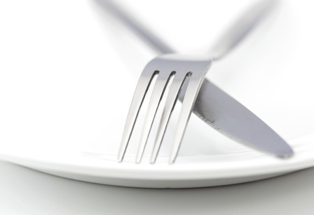 White plate, fork and knife on white background