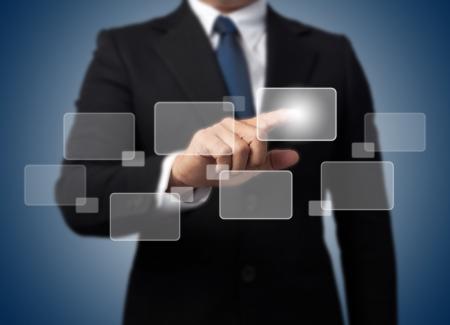 Businessman touching high tech type of modern buttons on a virtual background  Banco de Imagens