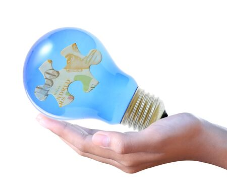 puzzle in bulb on hand Stock Photo - 13814179
