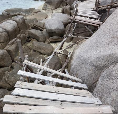 old damage wooden bridge by the sea nang yuan island photo