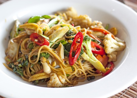 asian foods: Spicy seafood spaghetti with many kind of herbs   Stock Photo