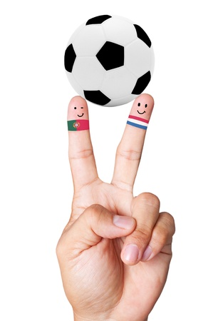 mondial: hand vicory with soccer ball concept as Portugal VS Holland