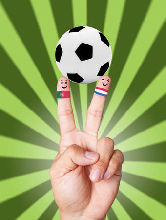 hand victory with soccer ball concept as Portugal VS Holland photo