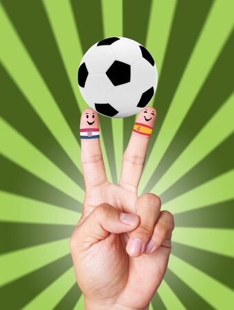 hand victory with soccer ball concept Croacia VS Spain photo