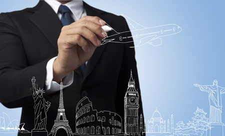 businessman drawing the concept travel around the world  photo