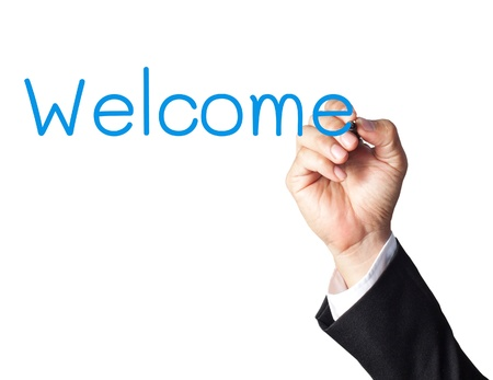businessman hand writing welcome on white board photo