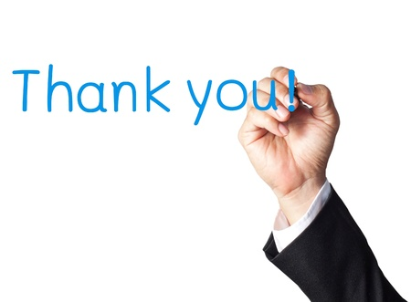 businessman hand writing thank you on white board photo
