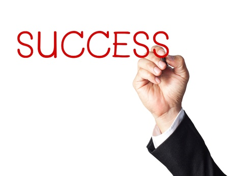 businessman hand writing success on whiteboard photo