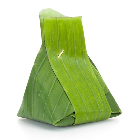 food package: Thai dessert, Sticky rice with steamed custard, wrapped in banana leaves
