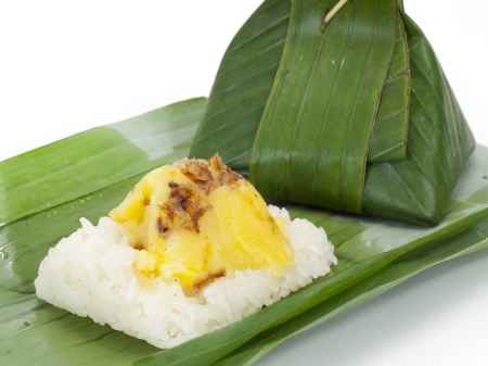Thai dessert, Sticky rice with steamed custard, wrapped in banana leaves  photo