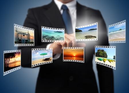 Businessman pushing many image button on the whiteboard   photo