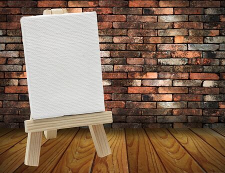 wood easel with white canvas in vintage room wood floor photo