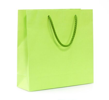 green shopping bag isolated on a white background photo