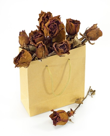 dried roses in a paper bag photo