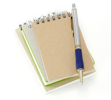 stack of ring binder book or notebook and pen isolated on white background  photo