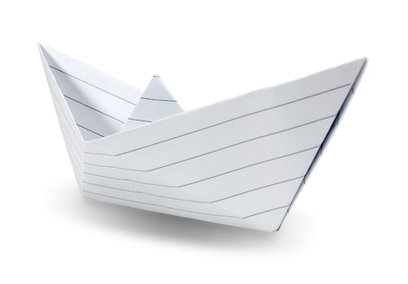 Origami paper ship isolated on white background  photo