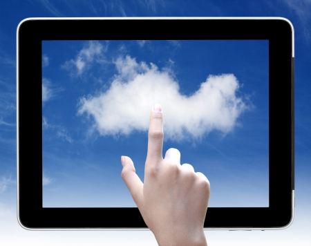 hand touch  cloud on tablet pc, concept of cloud computing