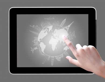 hand touch on tablet pc to drawing travel around the world  photo