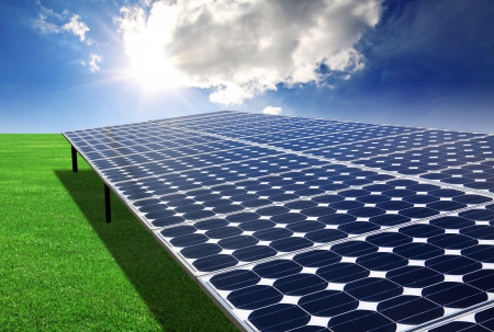 Solar panel in the green field Stock Photo