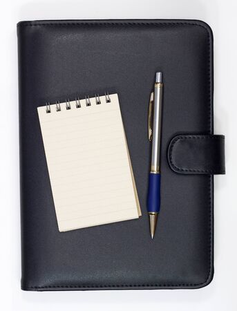 Black note book and open note book with ballpoint pen photo