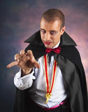 portrait of a handsome young man in a suit of Count Dracula photo