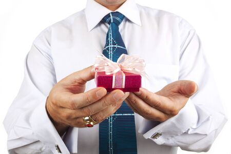 business man handed a box with a gift in hand photo