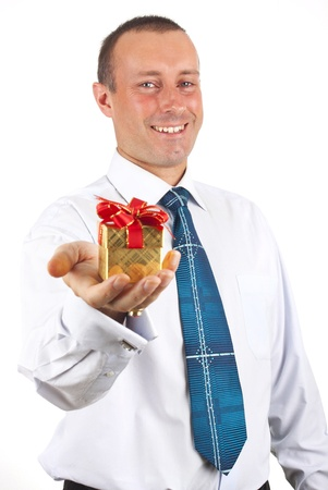 portrait of young business man handed a box with a gift in hand photo