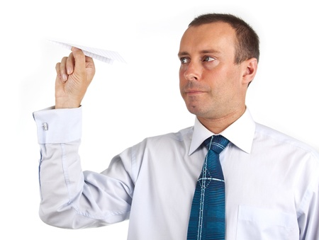 businessman throwing a paper airplane  photo