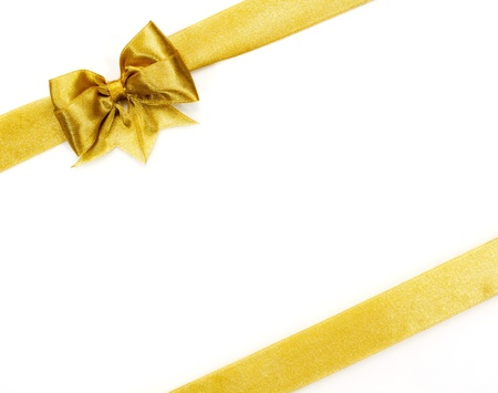 ribbon box: Golden satin gift bow  Ribbon on white  Stock Photo