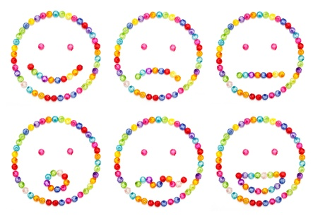 smily: A set of very original emoticon  decorate by colorful beads on white background