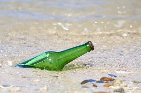 bottle with message on the beach  Stock Photo - 16759132