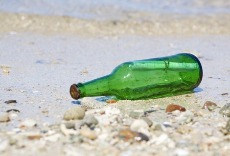 castaway: bottle with message on the beach