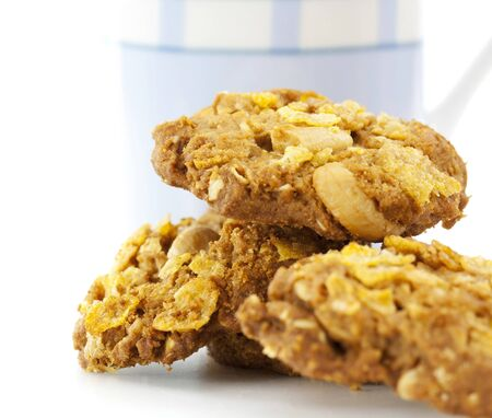 oat cookies biscuits and a white and blue glass of milk Stock Photo - 16835356