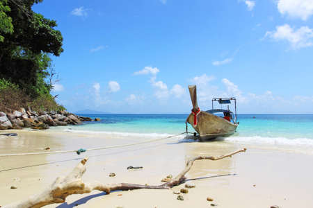 Tropical beach with thai longtail boat, Andaman Sea, Thailand Stock Photo