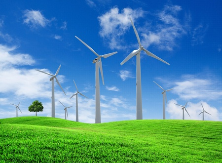 Wind turbines farm on green field landscape photo