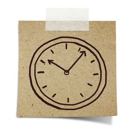 hand draw clock on note taped recycle paper photo
