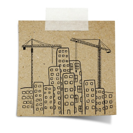 tall buildings: hand draw  of city development with crane, and building background  on note taped recycle paper