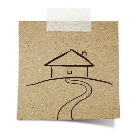 hand draw house on note taped recycle paper photo