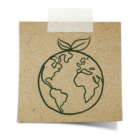hand draw green earth with leave on note taped recycle paper photo