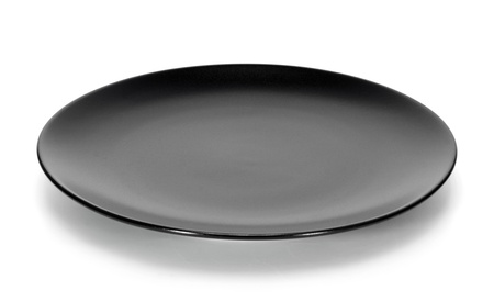 Black plate isolated on white background  写真素材