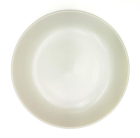 Cream china plate on white background photo