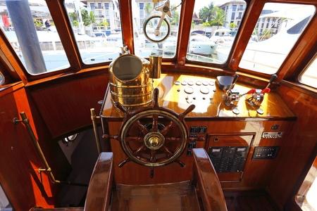 ship deck: steering wheel on a luxury yacht cabin
