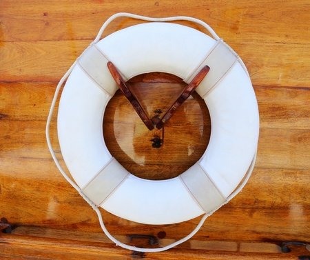 Life Buoy attached to a Wooden Paneled Wall photo